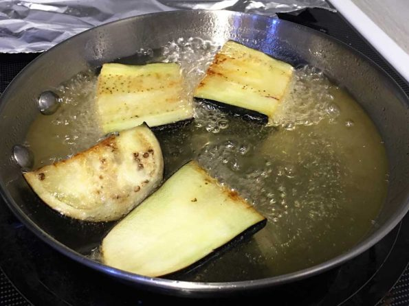 frying eggplant slices in oil