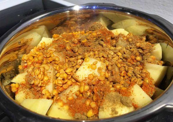 making potato sambar for rice dosa idli