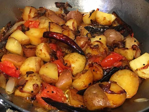 pan fried baby potatoes with tomatoes