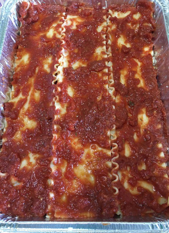 layering lasagna sheets sauce