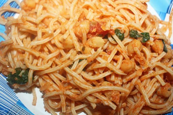 spaghetti rigati pasta with chickpeas and spinach leaves