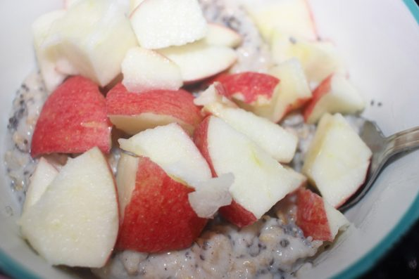 oats porridge topping with chopped apples and chia seeds