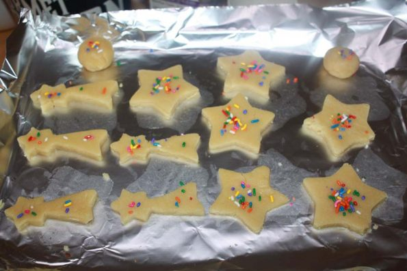 baking christmas sugar cookies with sprinkles