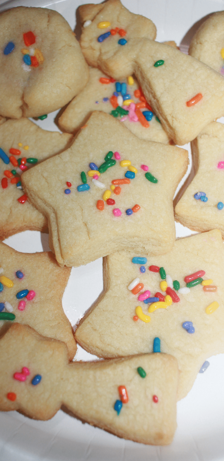 cut out sugar cookies with rainbow sprinkles
