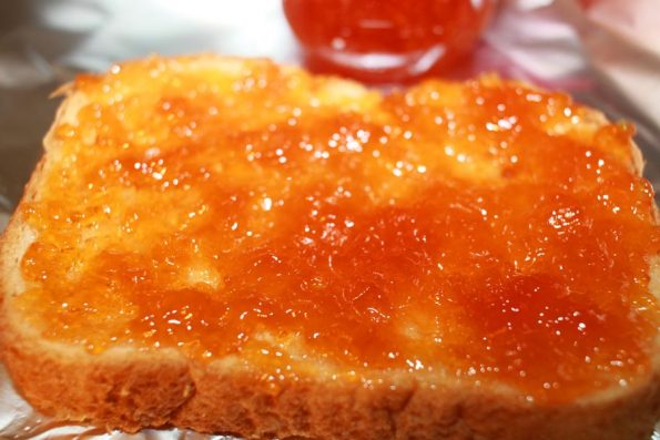 easy peach jam spread in bread slice