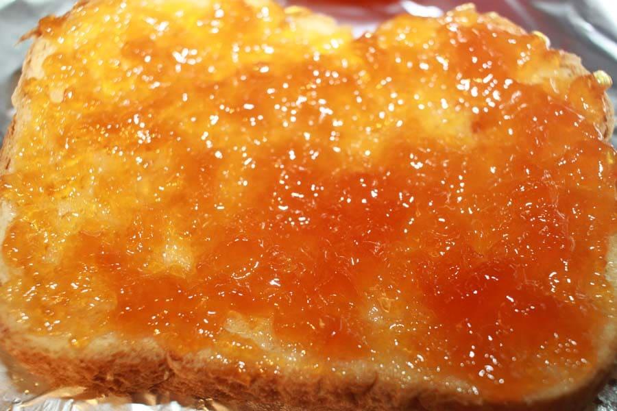 peach jam spread in bread