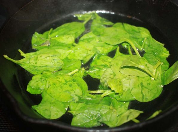 sauteing spinach to make scramble