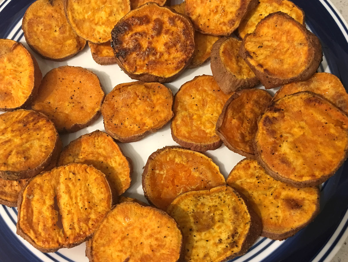 baked sweet potato slices in the oven
