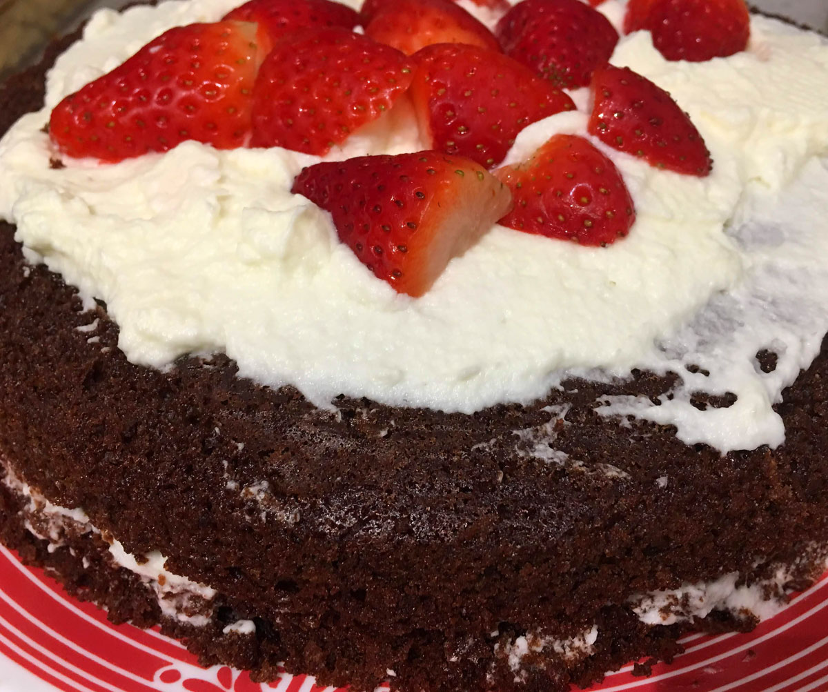 moist chocolate cake with strawberries and cream