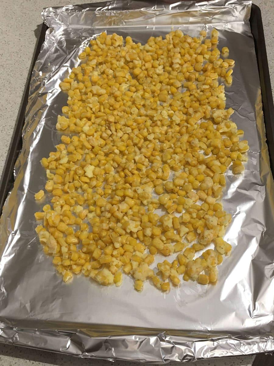 frozen corn in baking sheet