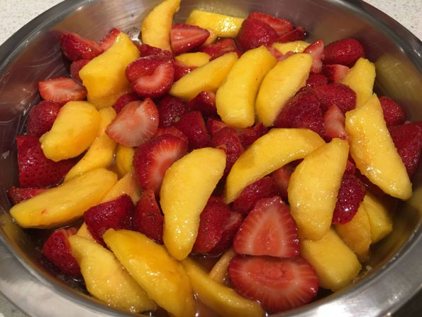 strawberries and peaches in pan