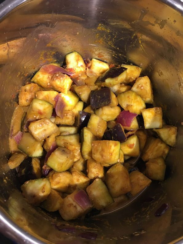 add spices, sauce, mix well