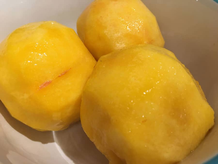 peeled yellow peaches