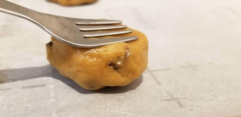 press with fork on cookie dough ball