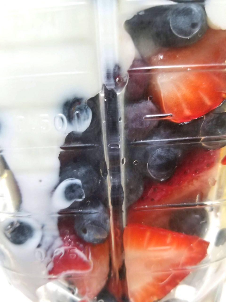 making berry smoothie with yogurt
