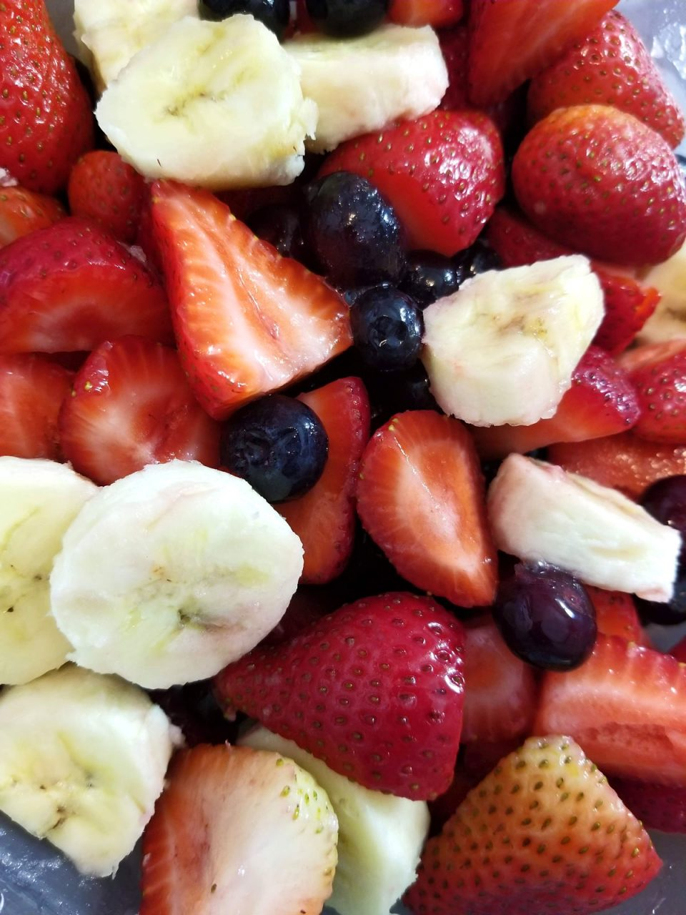 berry banana fruit salad with strawberries, blueberries and bananas