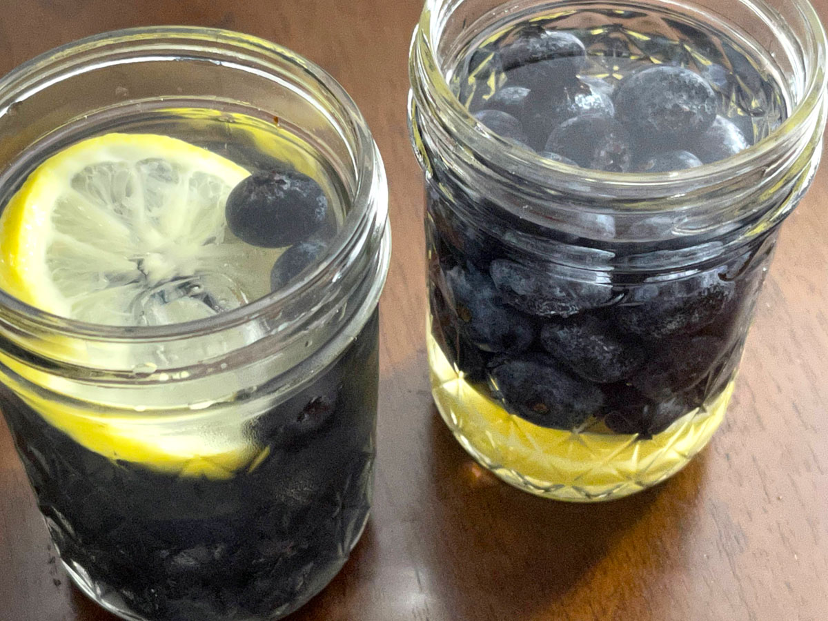infused water with berries and lemon slices